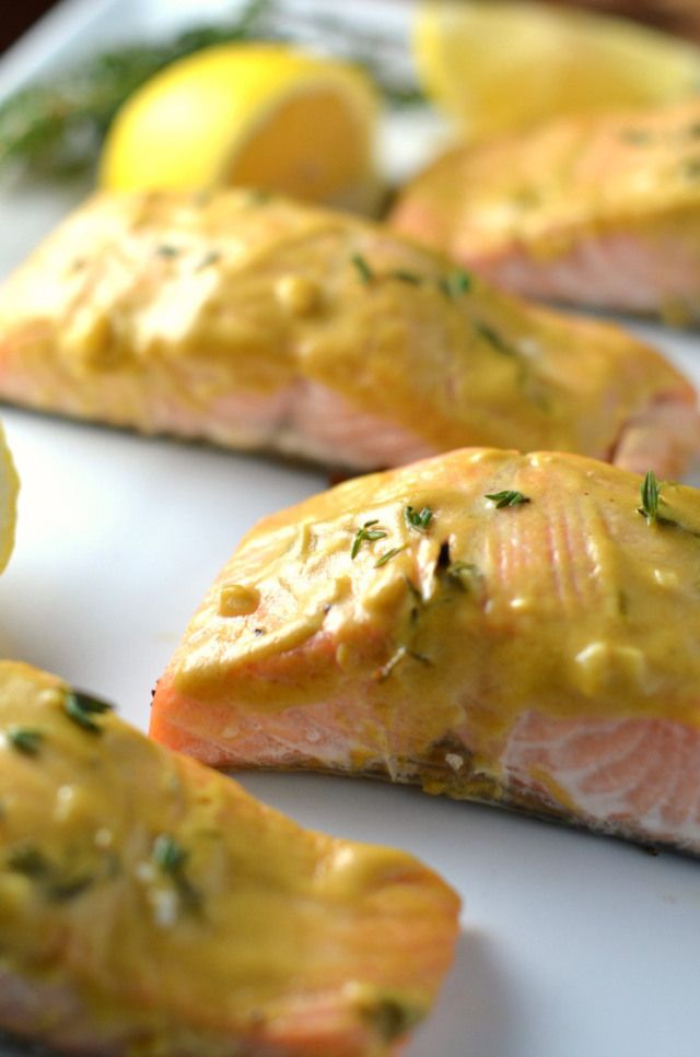 Baked salmon with a sauce made from lemon, dijon mustard, and fresh thyme. Clickthrough for the full recipe and more dinner ideas your family will love!