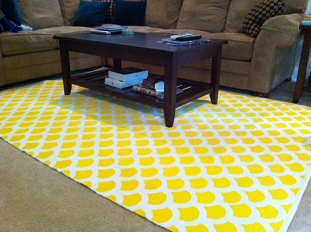 DIY Stenciled rug on a woven rug! I like this idea. Want to do this for my living room but not in yellow