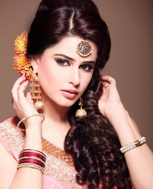bun hair style open curls and waves gorgeous indian bridal hairstyles 8113