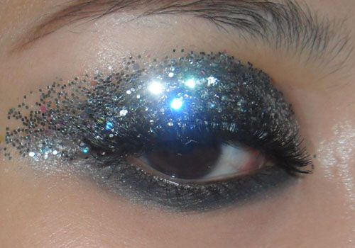 Fantasy Disco-Queen Eyes   —-  Please be forewarned that I used regular chunky art-store glitter for photographic purposes (cosmetic grade glitters don't show up well), and am not suggesting that you do the same.This is not comfortable and a pain in the behind to get off.  Only use micro-fine cosmetic-grade glitters around your eyes and you'll be much better off.  —-    Step 1: Apply black greasepaint to your lids, or black gel liner mixed with just a touch of baby oil. Anythin…