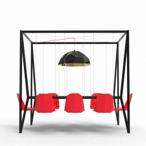 """Com o objetivo de trazer um pouco mais de diversão a mesa de reunião ou para a sala de jantar, o pessoal da Duffy London pensou na """"Swing Table"""", uma mesa de oito lugares com cadeiras que balançam. O playground deixa de ser algo só para crianças e vem para o ambiente interno com uma estrutura feita para suportar um lustre GEO e oito balanços."""