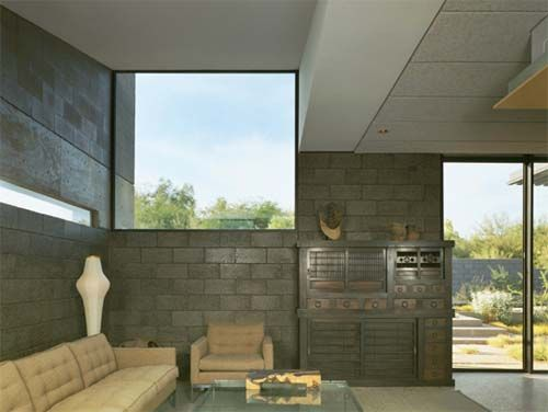 Concrete block living room of desert house 3d for Minimalist concrete house