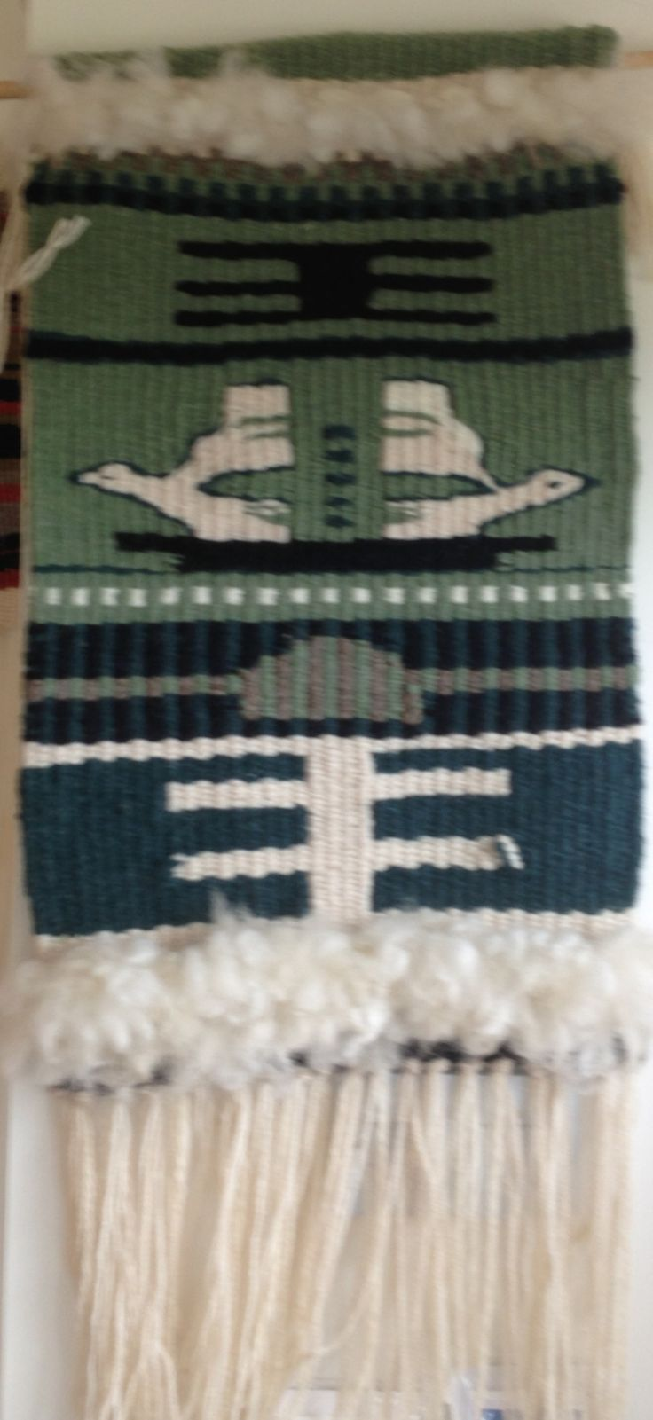 Green Navajo inspired wall hanging featuring white doves by Jackie Maddocks at Melin Trefin, Trefin, Pembrokeshire. www.melintrefin.co.uk