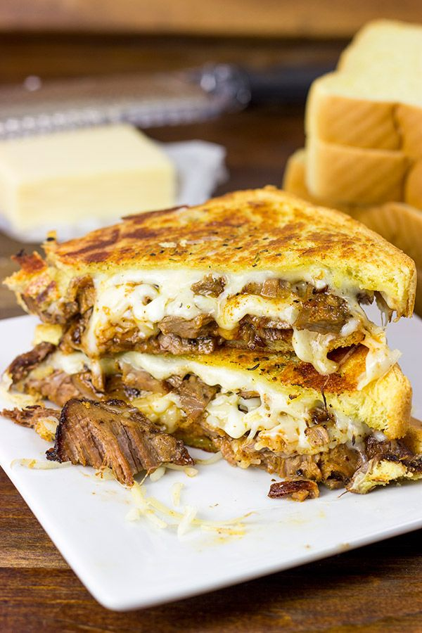 Smoked Brisket Grilled Cheese...  8 slices Thick-cut Bread, room-temp Salted Butter,  ½ tsp Italian Seasonings, ¼ tsp Garlic Powder, 4 oz. grated Gruyere, 4 oz. grated Sharp Cheddar, 4 oz. grated Monterey Jack,  12 oz. (2 c.) chopped Smoked Beef Brisket (homemade or restaurant), 4 T. Barbecue Sauce...