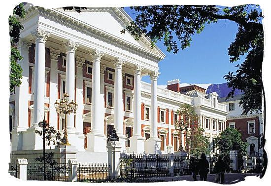 The picture shows the The Houses of Parliament in Cape Town where laws are made to help make South Africa a more efficient country and place for people to live in. The National national legislature has two houses: a 90-member National Council of Provinces and a 400-seat National Assembly.