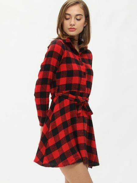 The classic checkered print is in and it's back with a sexy flair! Featuring a mini skater shirt dress with long sleeves and a cute tie belt that gives the dress the pleated skirt look. Pair with some