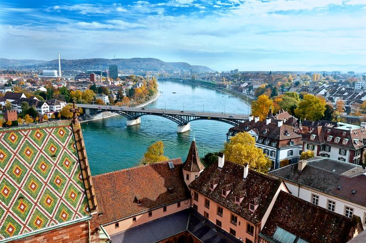 Basel, Switzerland. The river was the bluest I have ever seen, and the cathedral reminded me of Harry Potter. Here, I also saw rap music blasting during a basketball game inside another cathedral and an amazing twisted metal building. It was a great day!