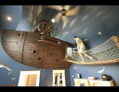 Amazing kid's pirate room complete with rope bridge and even a slide!