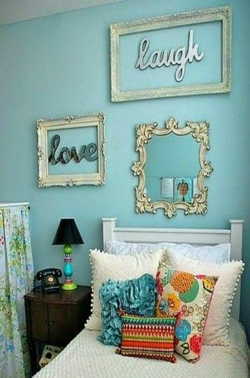 Live, Laugh, Love with frames on small wall in guest room