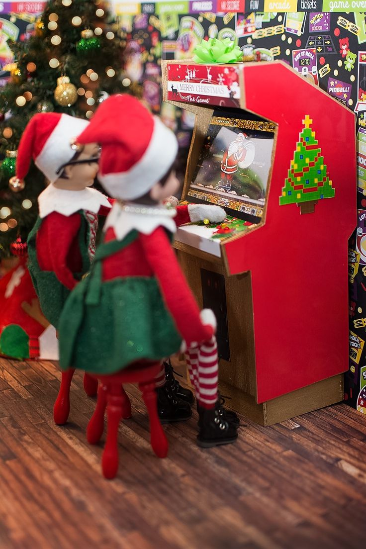 "Elf on the Shelf Ideas. The elves are playing ""Merry Christmas the Game"" at the North Pole Arcade. To view more pins like this one, search for Pinterest user amywelsh18."