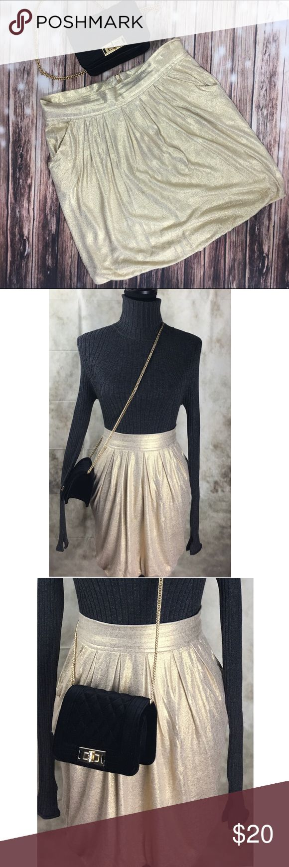 Zara Collection Soft Gold Balloon Hem Mini Skirt New Years Eve ready in this soft gold/champagne colored fun mini! This skirt is a women's size Medium, in excellent condition. Fully lined, balloon hem hits just above the knee. This skirt is fun and flirty for a night out on the town or an upcoming holiday party. Zara Skirts Mini
