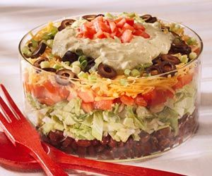 Layered Taco Salad For a spicier version of this pretty, tiered salad, use Monterey Jack cheese with peppers.
