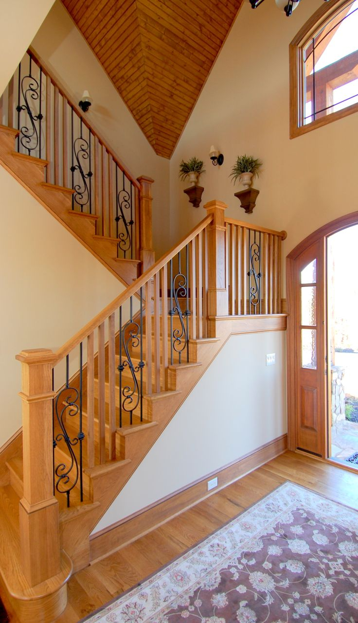 rustic lakefront home boast a all wood and iron staircase oak treads oak balluster and newel with powder coated wrought iron accent ballusters home