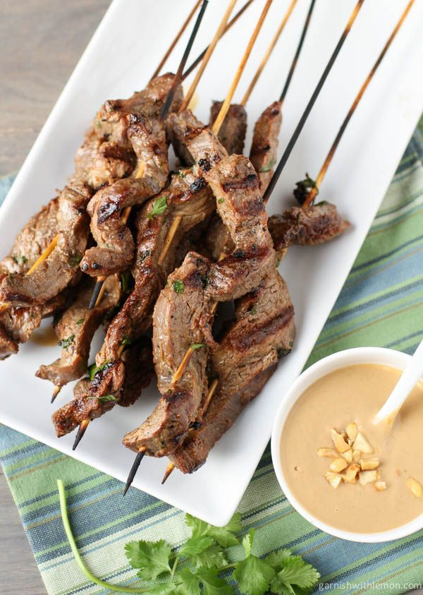Beef Satay skewers with an Asian Marinade and served with a creamy Thai peanut sauce.