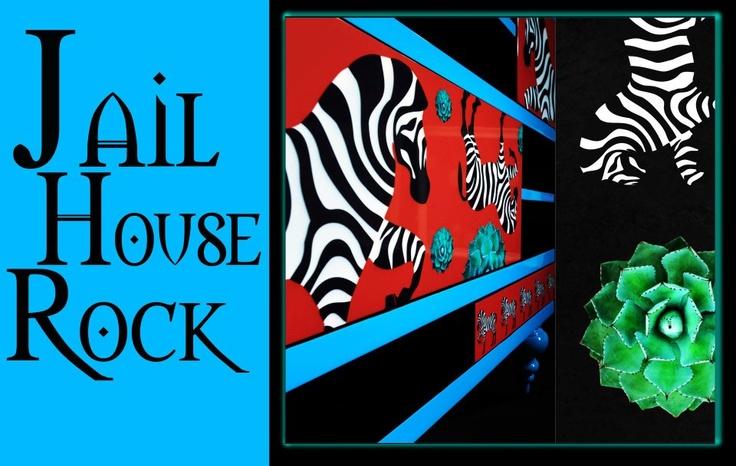 Black and white stripes juxtaposed against jail bars immediately call Elvis to mind,gyrating through Jailhouse Rock.