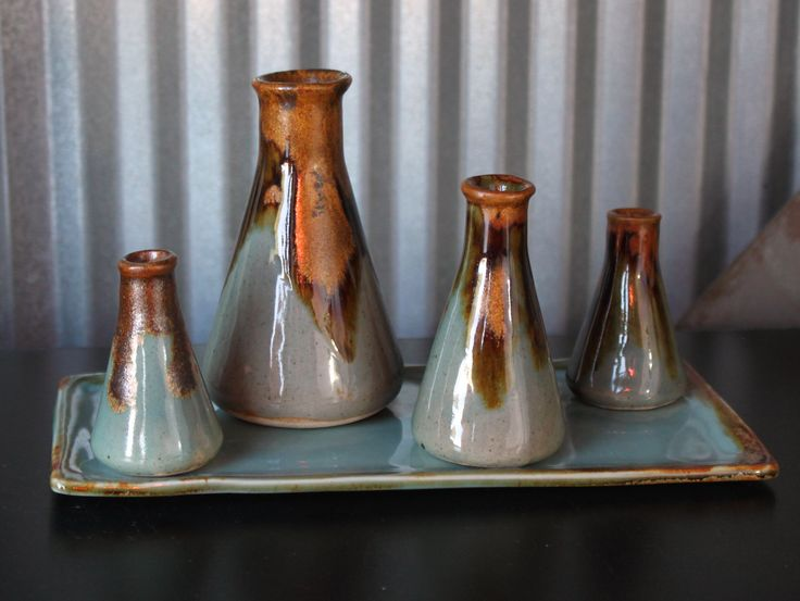 Bottles with tray - Jon Loer 2013 - Slipcast bottles an matching tray, blue celadon glaze with iron/rutile stain on the edges