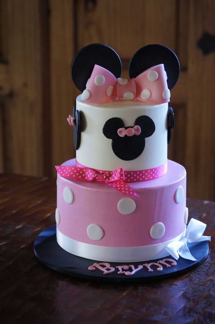 Pink and white Minnie Mouse themed birthday cake