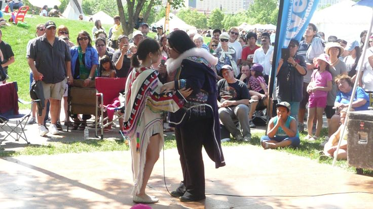 Inuit throat singers at Metis stage on Aboriginal Day Live  2013 at The Forks Winnipeg Canada