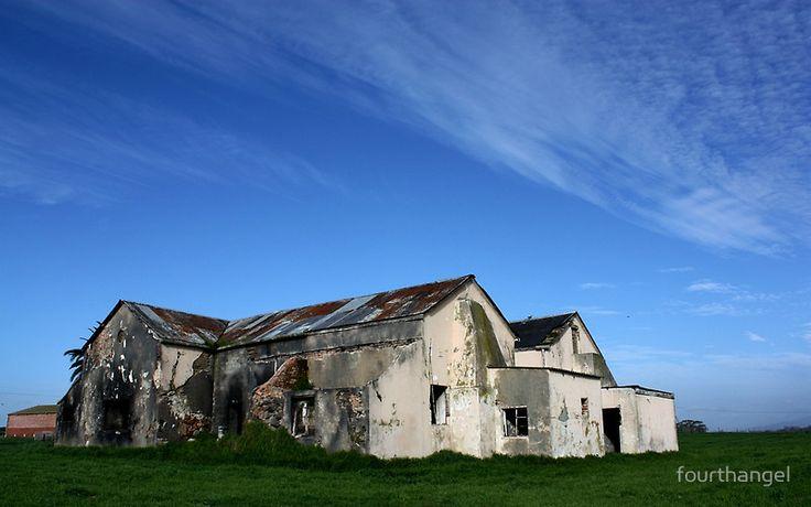 An abandoned old farm house – ruined by a long-ago fire, alongside a highway near Malmesbury, Western Cape, South Africa. fourthangel