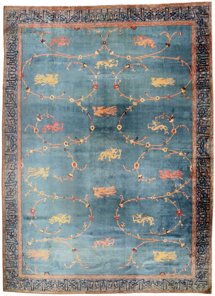 An antique Indian rug BB4527 - by Doris Leslie Blau.  A sophisticated early 20th century antique Indian rug, the rich sea blue field with a scrolling vine pattern ...