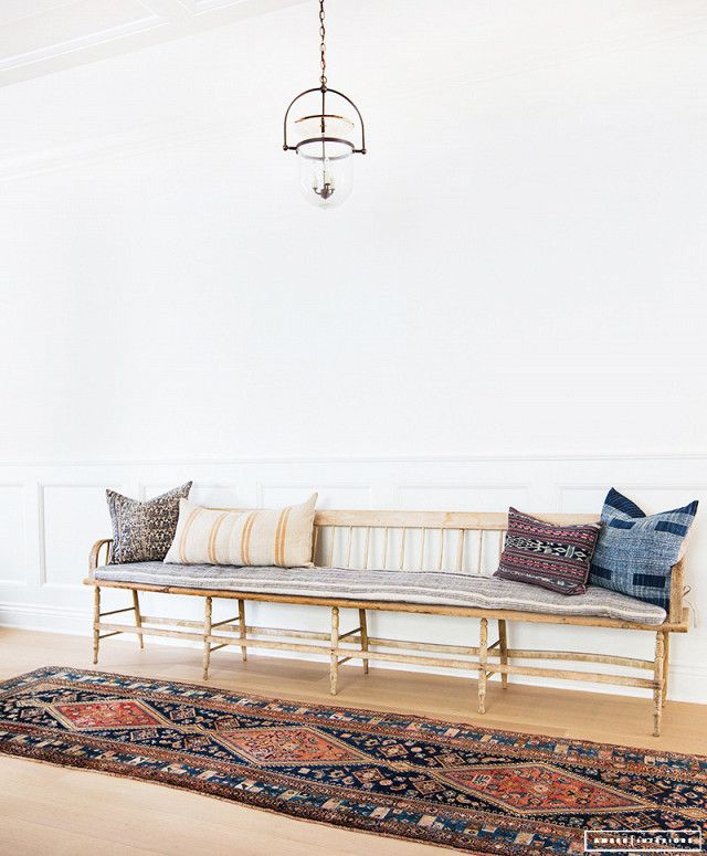 """The entire space is earthy and warm thanks to the designer's love of a neutral palette: Natural woods are fused with woven materials and textured patterns. """"I like to add texture and layers to all..."""