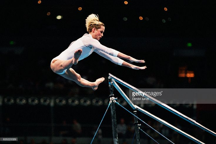 Svetlana Khorkina from Russia competes on uneven bars at the 2000 Olympics.