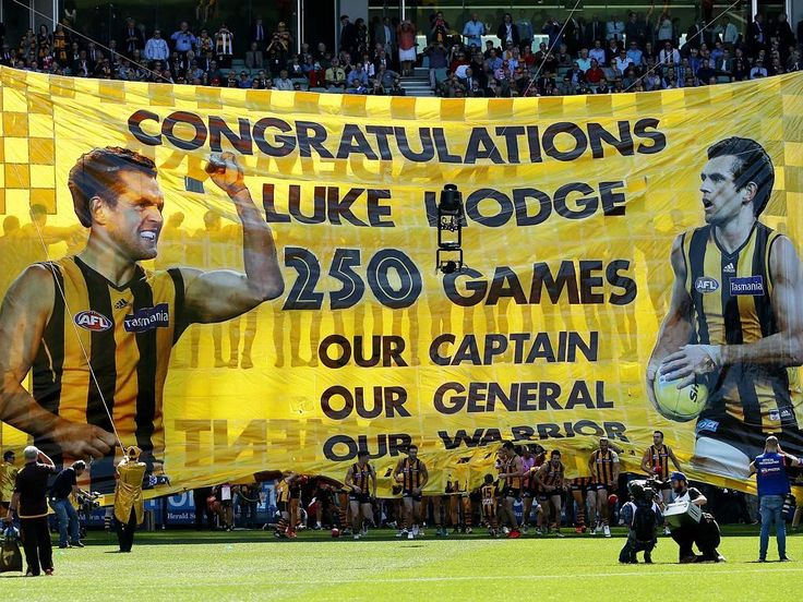 Hot Shots: Hodge's premiership heroes | Herald Sun | INSPIRATION: Hawks skipper Luke Hodge lived up to the message from the cheer squad on the banner. Picture: Colleen Petch.