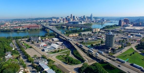 Cincinnati City Overheard by se7envideo Fly over park from Kentucky side gradually rising up towards the Ohio River and the Cincinnati skyline.Ultra smooth enabling you t