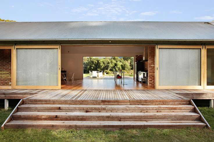 Industrial Patio by Maxa Design - <3 that there is no barrier between the interior and exterior spaces but where I live you would need screens to keep out the bugs...