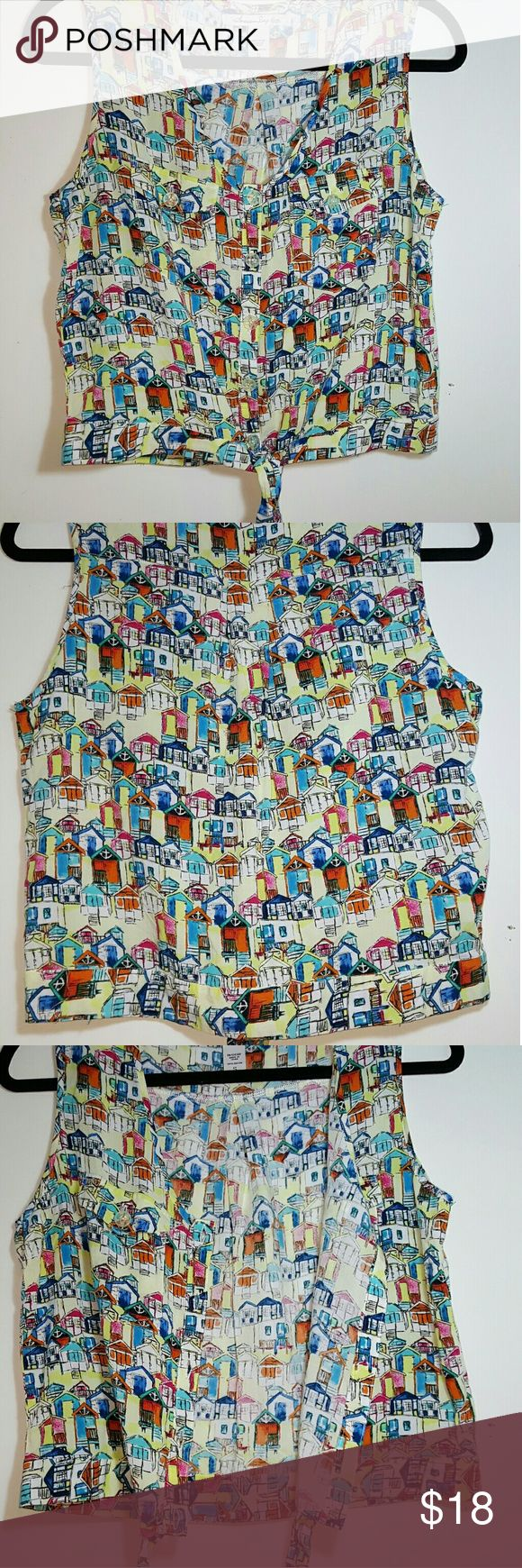 Super Colorful Fun Sexy Small/Medium Crop Top Super Colorful Fun Sexy Small/ Medium Crop Top With Waist Tie  It is button up and has two front pockets. It has a colorful pattern of little village houses throughout! With little anchors.  Style:Crop Top Sleeve Style: Sleeveless  Fresh and Super Soft  MADE FROM A LIGHT BREATHABLE MATERIAL  Size:  SMALL MEDIUM Chest:  17 INCHES---- 34 ALL AROUND  This is a perfect piece to pair with High waisted Jeans/shorts or a Nice pencil skirt.   PERFECT…
