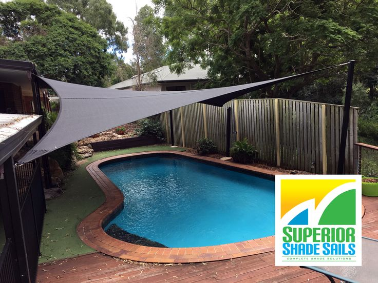 Pool shade sail installation at Barellan, Brisbane - 6 point sail with sail track for pool and leaf cover.