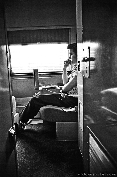 "On the train from New York City to Chattanooga, Tennessee, Elvis Presley listens to the acetate (gramophone record made from the master tape) of ""Hound Dog,"" ""Don't Be Cruel,"" and ""Any Way You Want Me,"" and hears his music as his fans will hear it on a cheap record player, 1956  by Alfred Wertheimer"
