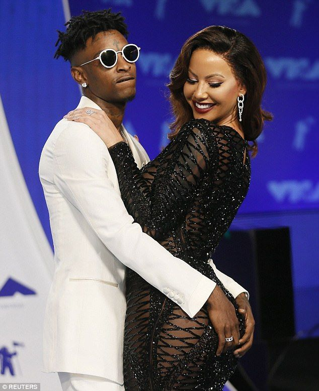 Up for grabs: Amber Rose's boyfriend 21 Savage got very hands-on at the MTV Video Music Awards at The Forum in Inglewood, California, on Sunday night