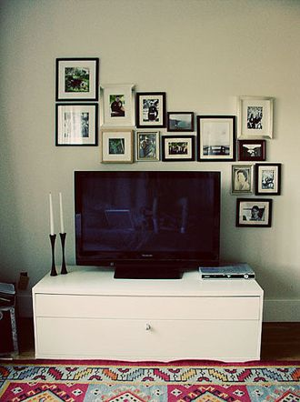 love the arrangement of frames to balance out the tv.