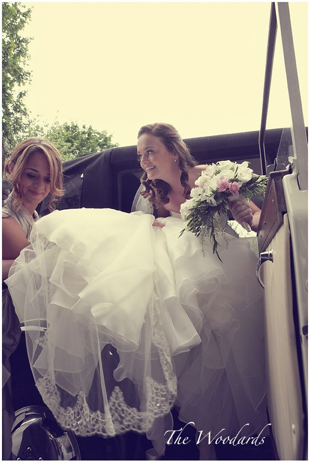 Liz being assisted by her sister as she arrives at the church.  Venue Dromoland Castle. Image by Woodard Photography #dromolandcastle