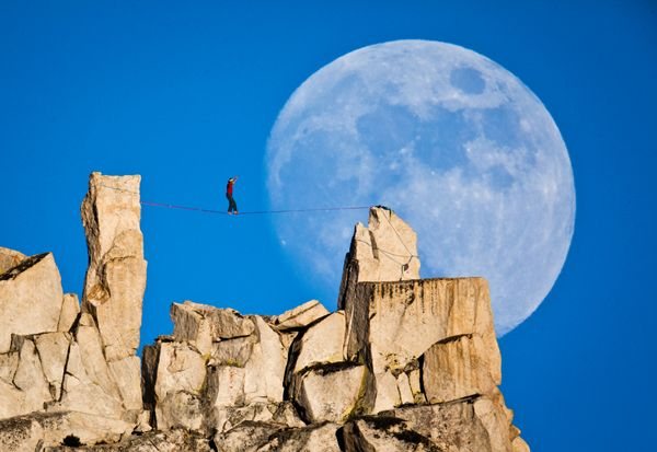 Dean Potter highlining in Cathedral Park, Yosemite, California perfectly timing it with the rise of an incredible full moon.  Doesn't it just make you want to go out and be adventurous and crazy?