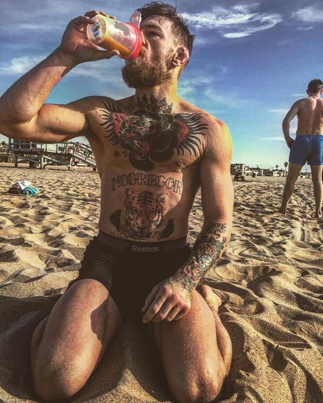 Conor McGregor enjoying the beach in Los Angeles : if you love #MMA, you'll love the #UFC & #MixedMartialArts inspired fashion at CageCult: http://cagecult.com/mma
