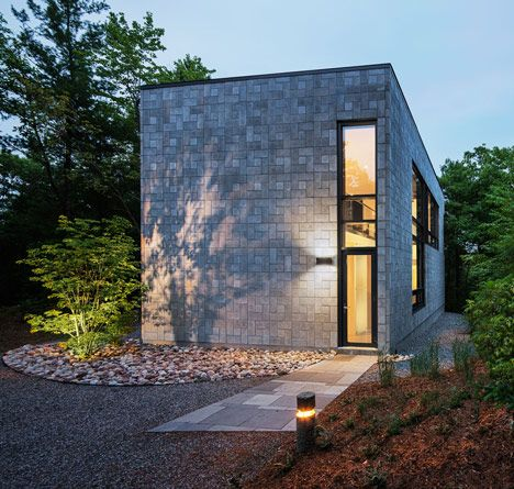 Concrete bricks create geometric patterns on the facade of this house in Québec by architects Kariouk Associates (+ slideshow).