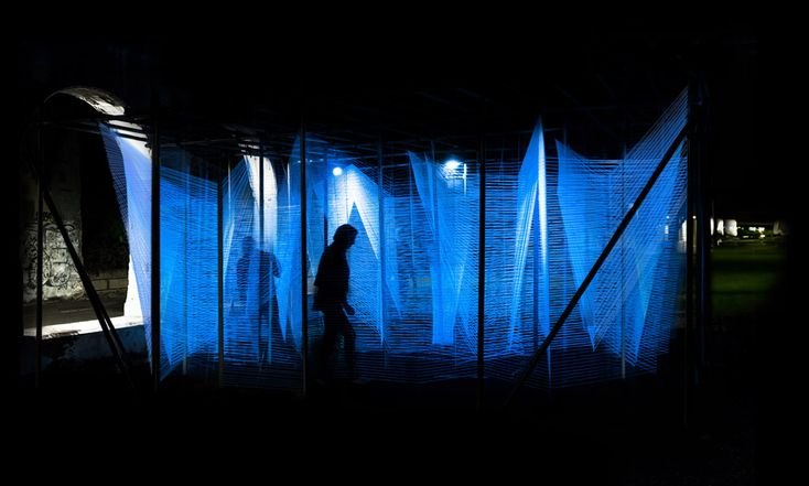 George King weaves UV string to create glowing maze-like installation in Detroit