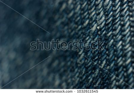 close-up of jeans texture, denim , linen , fabric background. Small depth of field. Selective focus