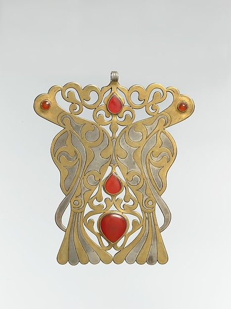 Pectoral Ornament Object Name: Ornament Date: late 19th–early 20th century Geography: Central Asia or Iran Medium: Silver; fire-gilded and chased, with openwork and table-cut and slightly domed and cabochon carnelians