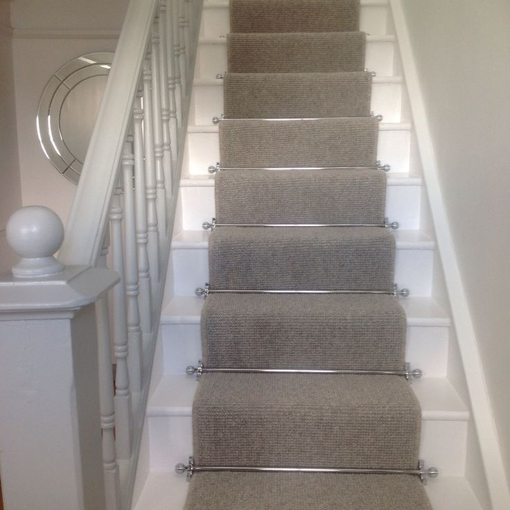 Runner on stairs with grey carpet with chrome bars