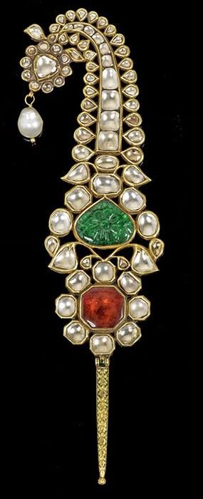Gem-set, enameled, gold Turban Ornament (Jigha) North India, 18th Century It is set with diamonds, a carved emerald and a pink tourmaline. Given by Maharaja Ranjit Singh (1780-1839) to Maharaja Sahib Singh of Patiala (1773-1813) in 1808. Private UK collection. Bonham's.