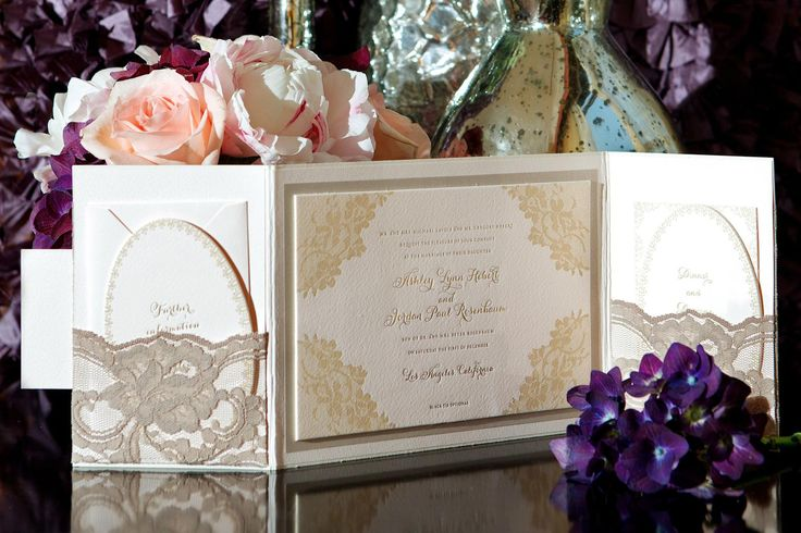 Ashley Hebert and J.P. Rosenbaum's weddin invitations were embellished with delicate, champagne-hued lace pockets. #weddinginvitation #weddingstationery Photography: Bob & Dawn Davis Photography. Read More: http://www.insideweddings.com/weddings/ashley-hebert-and-jp-rosenbaum/438/