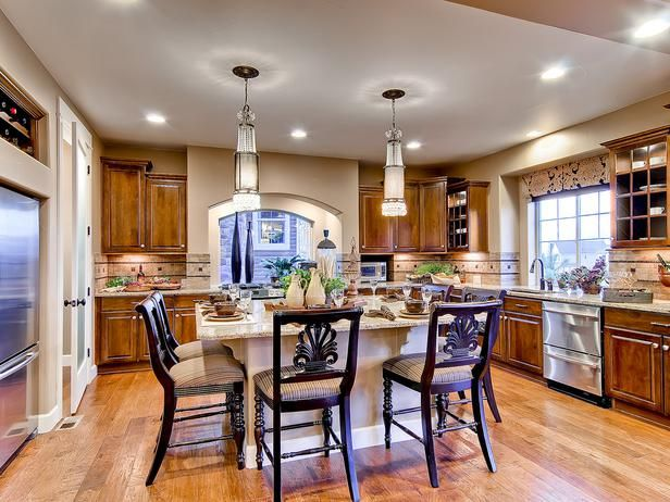elegant island lighting in the center of this kitchen a large island provides seating for center island lighting