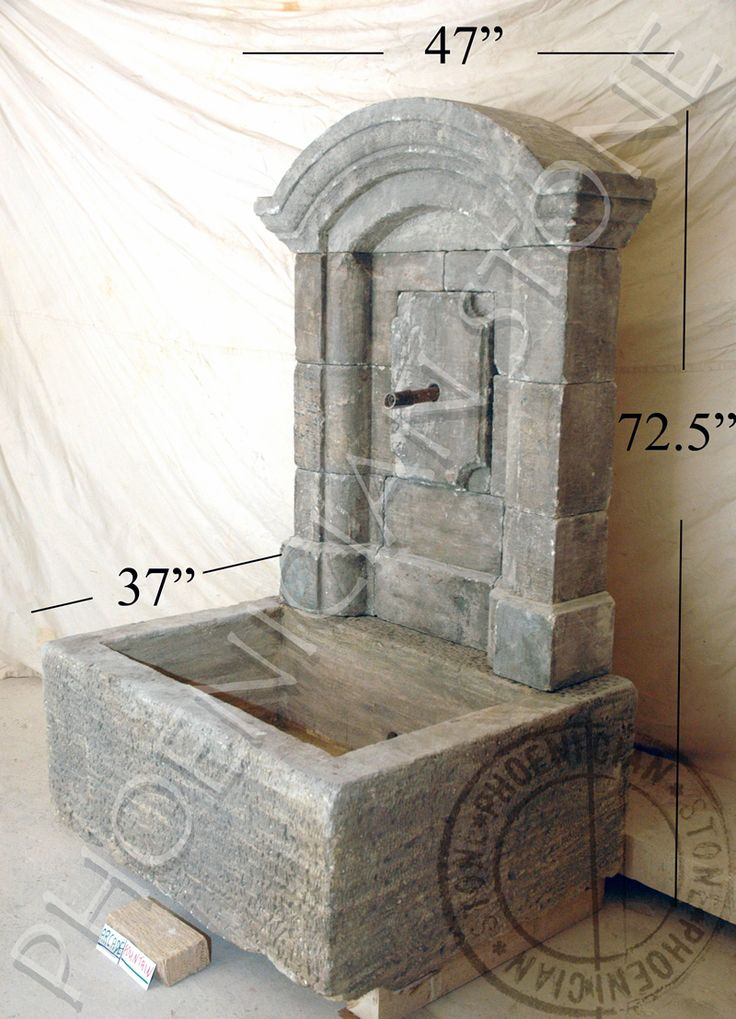 You are looking at a fine example of one of our antique reclaimed stone wall fountains that we stock locally. To learn more about us visit our website at:  http://www.phoenicianstone.com/fountains.html