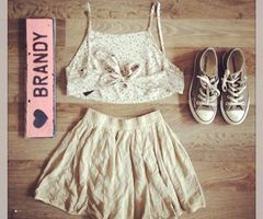 brandy melville outfit,brown converse,cream skirt and floral strap crop top
