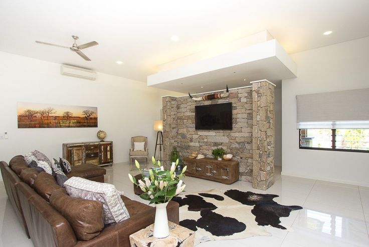 Living area with rustic stone wall (SD Interiors)
