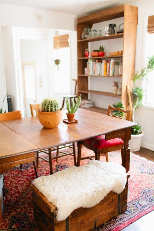 love the warmth, large but open-backed bookshelf, table with different chairs