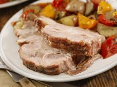 Slow roasted pork shoulder - made with a boneless pork shoulder or Boston blade roast or boston butt - Lauri Patterson / Getty Images